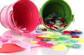 Colorful buttons strewn from buckets close-up — Stock Photo