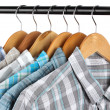Shirts with ties on wooden hangers isolated on white — Foto de Stock