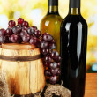 Composition of wine and grapes on wooden barrel on bright background — Foto Stock