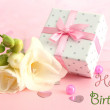 Stock Photo: Beautiful romantic gift box and flower on pink background