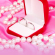 Wedding rings in red box on pink cloth background — Stock Photo #24644459