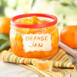 Royalty-Free Stock Photo: Orange jam with zest and tangerines, on white wooden table