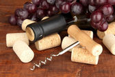 Wine and corks on wooden table — Stock Photo