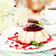 Panna Cotta with raspberry sauce, on bright background - Stock Photo