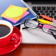 Laptop with stationery and cup of coffee on table — Stock Photo #24654981