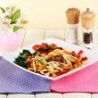 Stock Photo: Noodles with vegetables on plate on wooden table