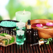 Spa composition with aroma oils on table on bright background — Stock Photo #24655833