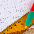 Math on copybook page closeup - Stock Photo