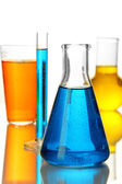 Test tubes with colorful liquids isolated on white — Stock Photo