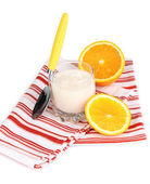 Delicious yogurt in glass with orange isolated on white — Stock Photo