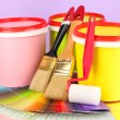 Set for painting: paint pots, brushes, paint-roller, palette of colors on lilac background — Stock Photo #24708057