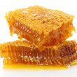 Sweet honeycombs with honey, isolated on white — 图库照片