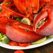 Royalty-Free Stock Photo: Red lobster on platter on table close-up