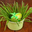 Royalty-Free Stock Photo: Easter eggs in bowl with grass on wooden table close up