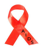 Aids awareness red ribbon isolated on white — Stock Photo
