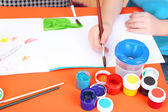 Child painting in his album — Stock Photo