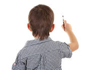 Cute little boy drawing isolated on white — Stock Photo