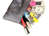 Items contained in the women's handbag isolated on white — Stock Photo