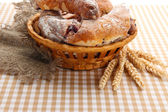 Taste croissants in basket on tableclot — Stock Photo