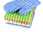 Blue potholder and stack of kitchen towels isolated on white — Stock Photo