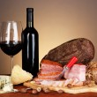 Exquisite still life of wine, cheese and meat products — Stock Photo #24756769