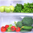 Open refrigerator with vegetarian food — Stockfoto