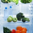 Open refrigerator with vegetarian food — Foto de Stock