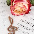 Treble clef and rose on musical background - ストック写真