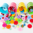 Colorful buttons strewn from buckets isolated on white - Foto de Stock