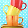 Three cups on bright background — Stock Photo #24757789