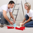 Young couple doing renovation togethe — Stock Photo