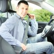 Royalty-Free Stock Photo: Portrait of young man sitting in the car