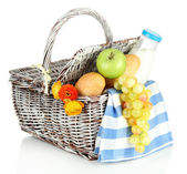 Picnic basket with fruits and bottle of milk, isolated on white — Stock Photo
