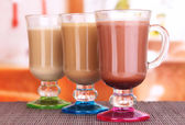 Layered coffee in glass on table on bright background — Stock Photo