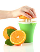 Preparing fresh orange juice squeezed with hand juicer, isolated on white — Stock Photo