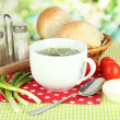 Stock Photo: Fragrant soup in cup on table in garden