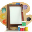 Photo frame as easel with artist's tools isolated on white - Stock Photo