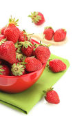 Sweet ripe strawberries in bowl isolated on white — Stock Photo