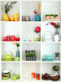 Beautiful white shelves with tableware and deco — Foto de Stock