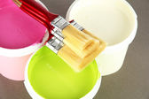 Set for painting: paint pot, brushes on grey background — Stock Photo