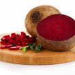 Sliced beetroot on board isolated on white — Stock Photo #24800833