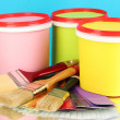 Set for painting: paint pots, brushes, palette of colors on blue background — Stockfoto