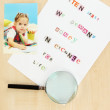 Letter to requirements of kidnapper on wooden table close-up - Stock Photo