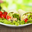 Kebab - grilled meat and vegetables, on bamboo mat, on bright background - Stockfoto