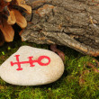 Fortune telling  with symbols on stone close up - Stock Photo