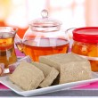 Tasty halva with tea on table in room — Stock Photo
