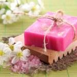 Natural handmade soap on bamboo mat — Stock Photo