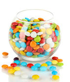 Colorful candies in glass bowl isolated on white — Stock Photo