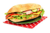 Fresh and tasty sandwich with ham and vegetables isolated on white — Stock Photo