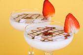 Fruit smoothies on beige background — Stock Photo